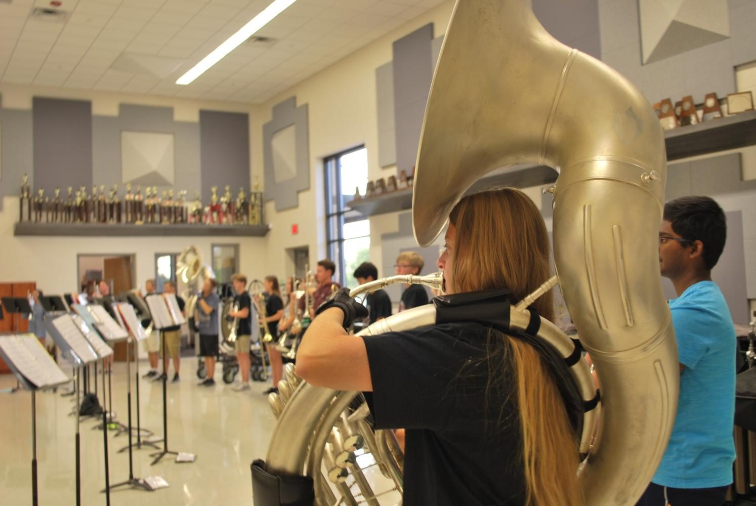 Deana Roberts plays a warm up on her sousaphone during Symphonic Band.